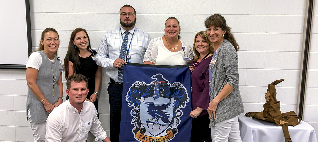 Winning team with their Harry Potter house flag