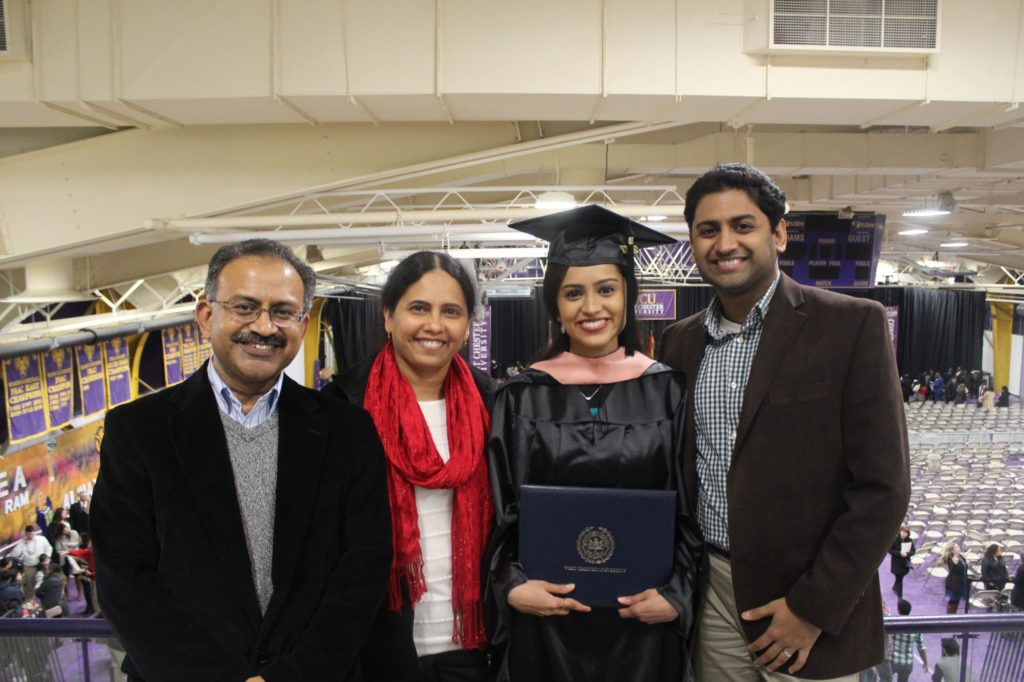 Adithi with family for graduation